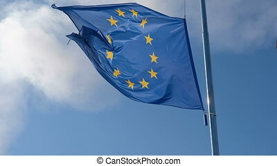 EU Flag Waving in Blue Cloudy Sky