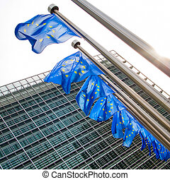 EU flag waving in front of European Parliament - European...