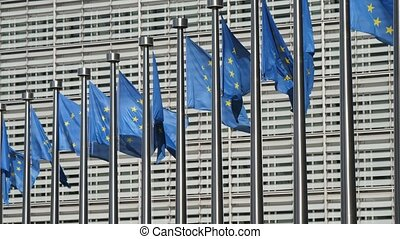 EU flags fluttering at high flagpoles at the European...