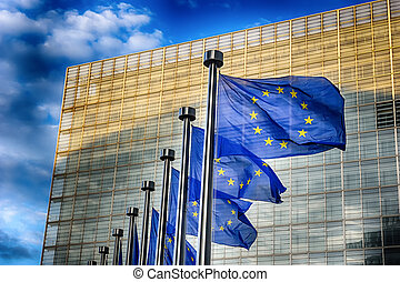 EU flags in front of European Commission building in...