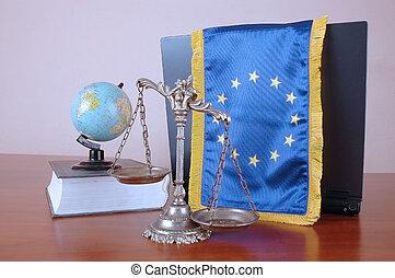 EU law - Decorative Scales of Justice, globe, book and EU...