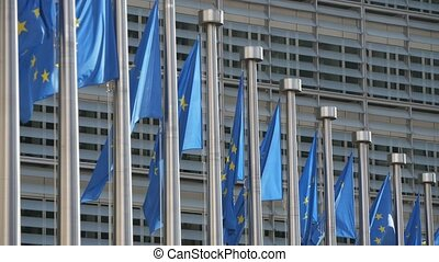 EU standards fluttering at flagpoles at the European...