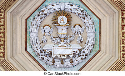 Eucharist chalice and wafer, stucco decoration, basilica of Saint Paul Outside the Walls, Rome, Italy