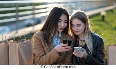 Euphoric friends watching videos on smartphone - Joyful...