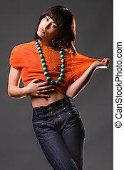 Eurasian fashon model on dark studio background
