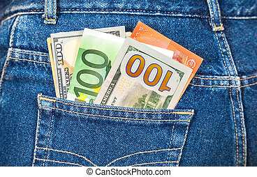 Euro and american currency, money in jeans pocket for travel and shopping