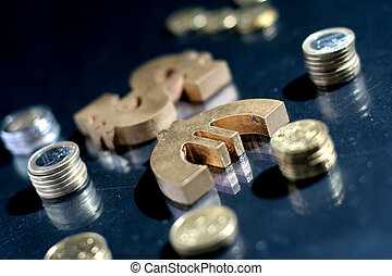 Euro and dollar symbol and coins.