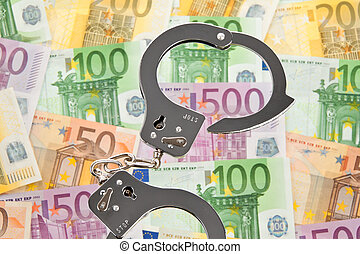 euro bank notes with handcuffs - many euro bank notes with...