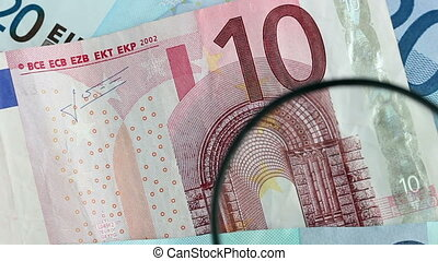 Euro banknote identification with magnifying glass