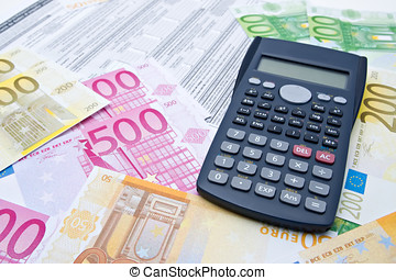 Euro banknotes and calculator
