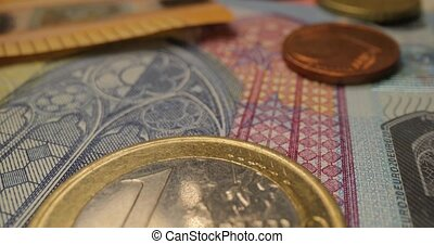 Euro currency coins and banknotes money macro slider shot, wide angle probe macro lens, 60 fps 4k footage