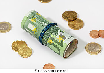 Euro banknotes and coins isolated on white background. Money concept