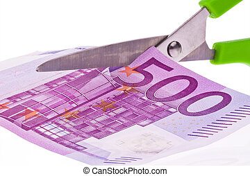 euro banknotes and scissors - by a € bill is cut off with ...