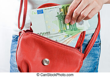 Euro banknotes in hand