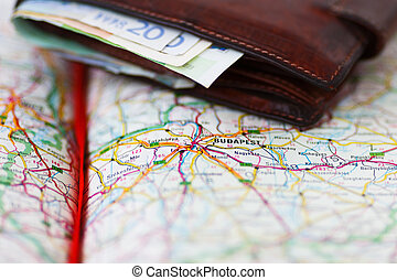 Euro banknotes inside wallet on a geographical map of Budapest