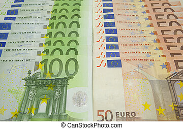 Euro banknotes - Several bills of 100 and 50 euros on the...