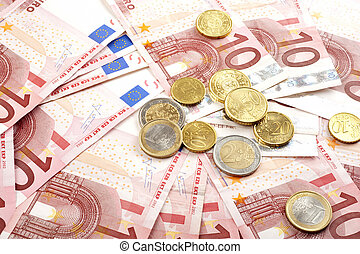 Euro banknotes with coins, financial background