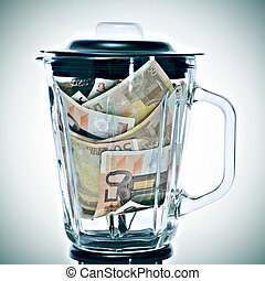euro bills in a blender - a pile of 50 euros bills in a...