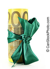 euro bills - Rolled euro notes with a green ribbon