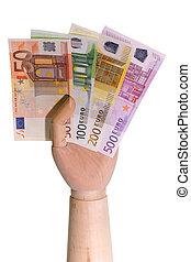 Euro Bills - Wooden hand holding Euro bills on white...