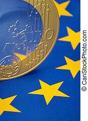 Euro coin on flag