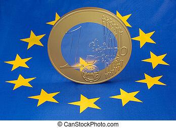 Euro-coin on flag