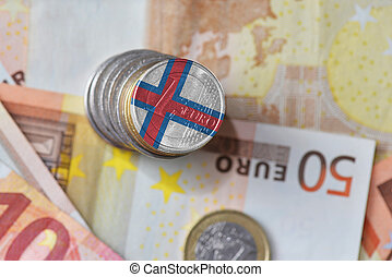 euro coin with national flag of faroe islands on the euro money banknotes background