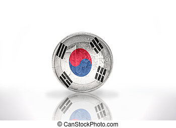 euro coin with south korea flag on the white background