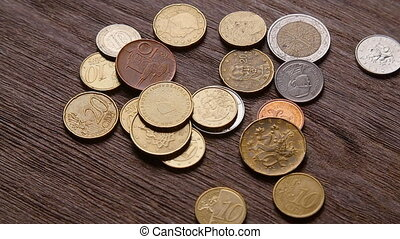 Euro coins and bitcoins are falling on the table - Euro...