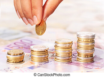 Euro coins and hand