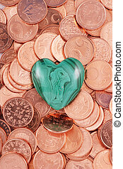 A heart of a gem stone with euro coins
