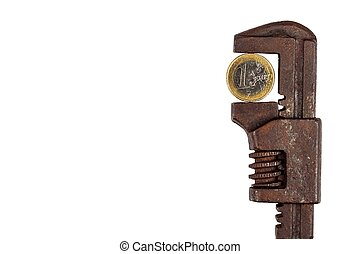 Euro coins in the clamp. Risk of economic crisis. The fall of the currency. Isolated on white.