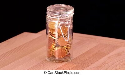 Euro coins in the glass.
