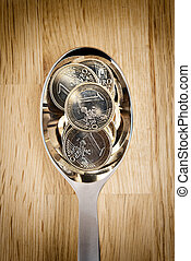 Euro coins on spoon
