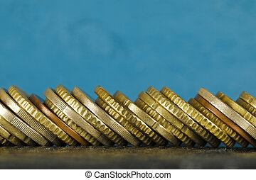 Euro coins stacked side by side