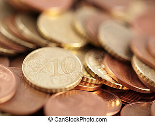 Euro coins with focus on a ten cents coin