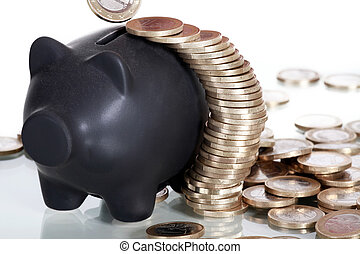 Euro coins with piggy bank