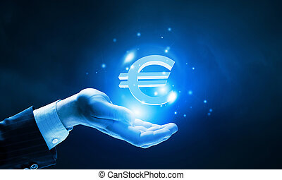 Euro currency - Close up of human hand holding golden euro...