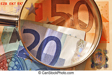 euro currency enlarged with a magnifying glass, euro in Europe