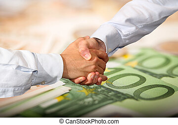 Euro Handshake - Handshake and Euro Banknotes Background