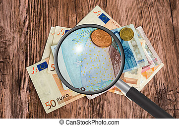 Euro money background with magnifying glass