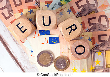 Euro Money - Banknotes and wood dice with the word euro