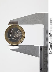 euro money coin sized by vernier tool on white background