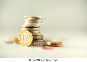 Euro money, currency. Success, wealth and poverty, poorness concept. Euro coins stack on grey background with copy space.