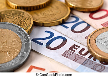 euro money - euro banknote money and coins, close up