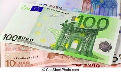 Euro money. Hand loupe. Dolly