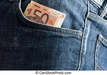 euro money in the front pocket of jeans