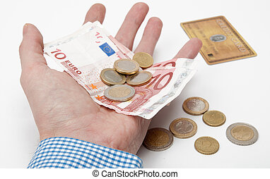Euro Money - male hand holding several Euros in his hand. In...