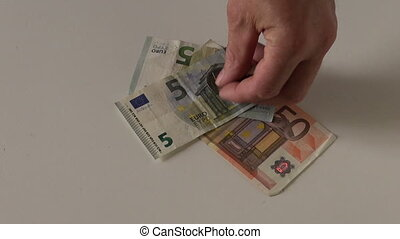 euro money on table and game dice - euro money cash on table...