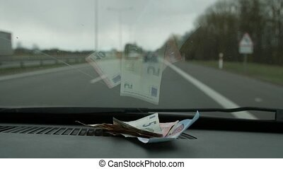Euro money placed in the car to the front glass. Close up -...
